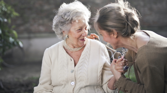 A caregiver assists a patient experiencing dysphagia following a stroke